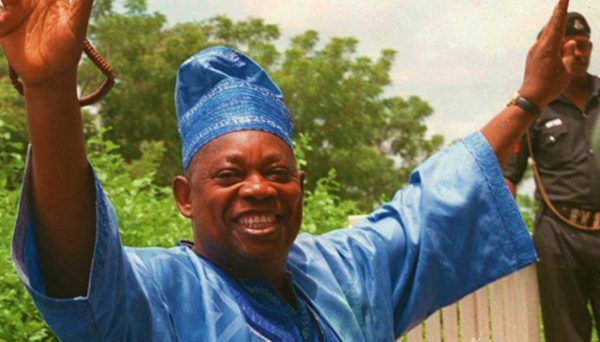 June 12 – Who Carries The Watering Can? By Emmanuel Yawe